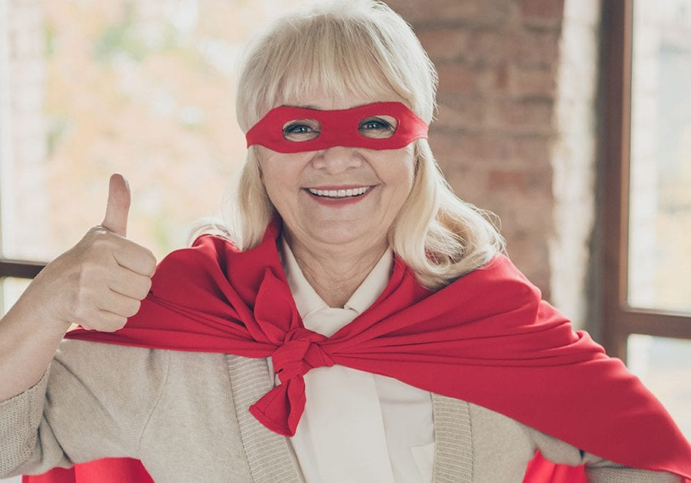 thumbs up masked older woman